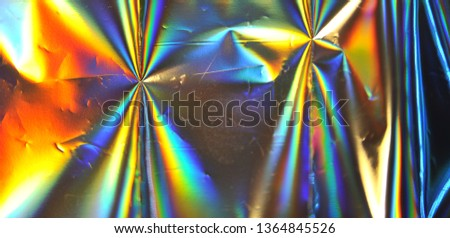 Photo of blurred holographic foil texture.