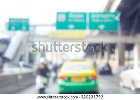 photo of blurred traffic and city background #320231792