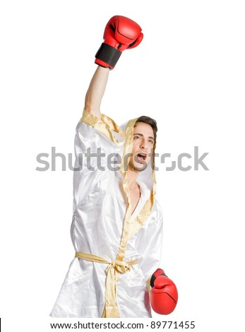 photo of boxer who has won the fight match holding is hands up