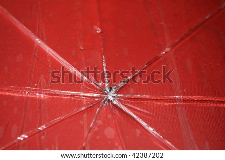 photo of broken red glass table