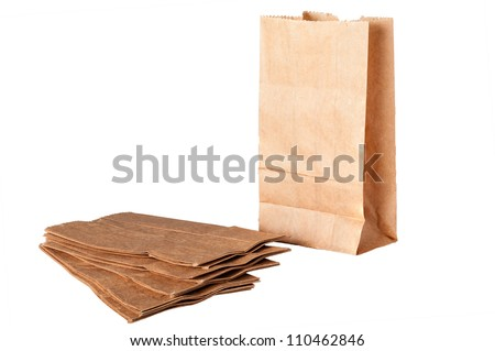 Photo of brown paper bags isolated on white background