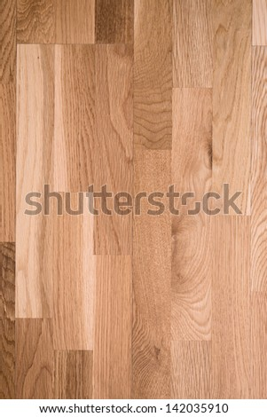 Photo of brown parquet as abstract texture background, top view