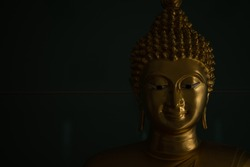 Photo of buddha statues are smiling on black background, photo for background or banner