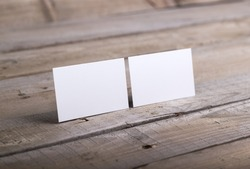 Photo of business cards. Template isolated on old wood background. For graphic designers presentations and portfolios damaged weathered antique mock-up with business cards
