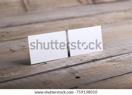 Photo of business cards. Template isolated on old wood background. For graphic designers presentations and portfolios damaged weathered antique mock-up with business cards #759138010