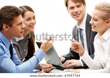 Photo of business lady sharing her ideas while looking at her co-worker with smile