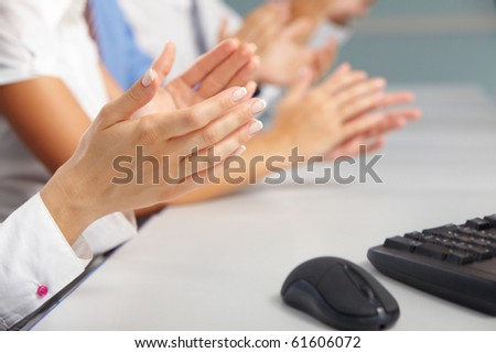 Photo of business partners hands applauding at meeting