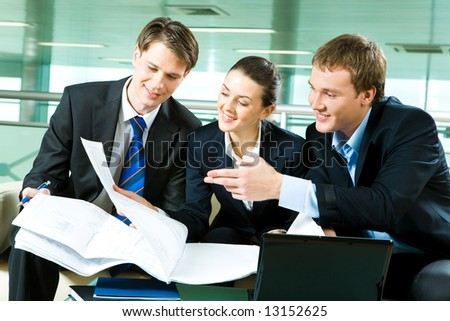 Photo of business partners planning together their work in the office