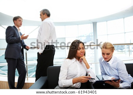 Photo of business people interacting at meeting