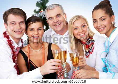 Photo of businesspeople with flutes of sparkling champagne