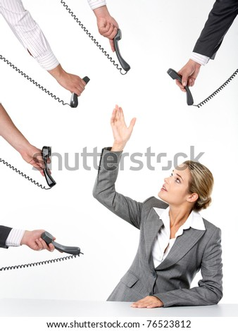 Photo of businesswoman going to take telephone receiver while being offered several of them