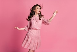 Photo of candid cute pretty girl look copyspace hold touch hand air wind blow haircut isolated over pastel color background