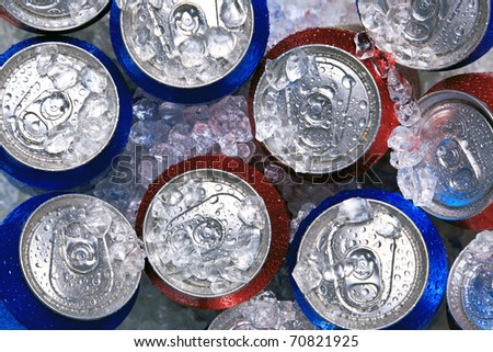 Photo of cans of drink on crushed ice. #70821925