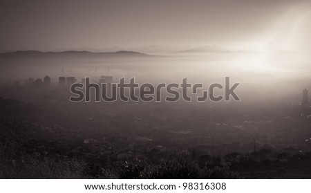 Photo Of Cape Town On A Misty Morning With Buildings Looking Through The Fog