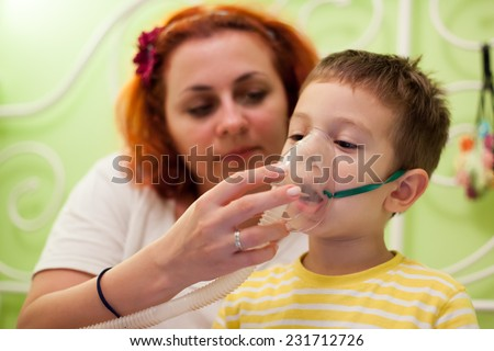 photo of caring mother and kid curing illness with aerosols inhalation