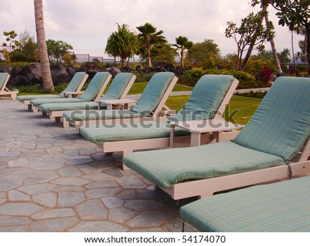 photo of chairs by a pool in a resort