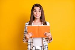 Photo of charming amazed student girl dressed plaid jacket holding open organizer isolated yellow color background