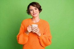 Photo of charming beautiful young girl hold coffee mug good mood cozy isolated on green color background