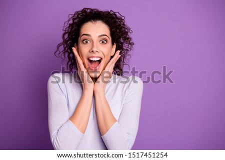 Photo of charming lady holding arms on cheeks open mouth enjoy reading black friday sale banner wear pullover isolated purple color background