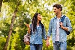 Photo of charming pair walking dormitory hostel after lessons enjoy sunny friday wear denim outfit
