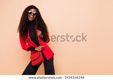 Photo of charming pretty dark skin young girl wear bag sunglass glamour isolated on beige color background Сток-фото ©