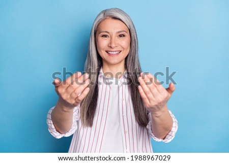 Photo of charming pretty happy old woman good mood invite young hands isolated on blue color background Сток-фото ©