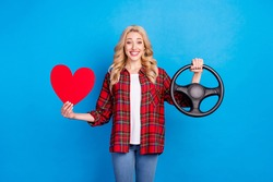 Photo of charming sweet young lady wear plaid shirt holding steering wheel red heart smiling isolated blue color background