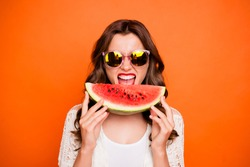 Photo of cheerful cute nice positive charming youth girl about biting wedge of juicy watermelon enjoying summer isolated over vivid color background in eyewear eyeglasses spectacles