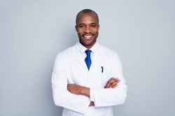 Photo of cheerful doctor dark skin guy virologist agent corona virus seminar conference arms crossed pandemic virus expert wear white lab coat tie isolated grey color background