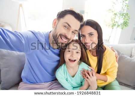 Photo of cheerful family happy positive smile make selfie record video enjoy time together sit couch indoors