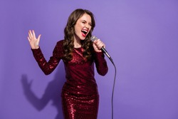Photo of cheerful funny beautiful lady festive party dance night sing mic song vocalist singer amazing voice wear sequins burgundy dress isolated pastel violet color background