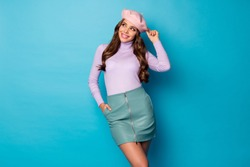 Photo of cheerful funny lady modern look outfit clothes look side empty space wear pink beret purple turtleneck jumper green leather mini skirt isolated blue color background
