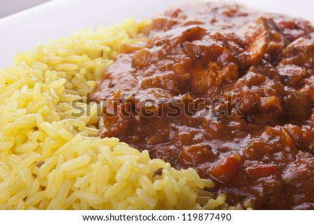 photo of chicken jalfrezi with pilau rice on a plate