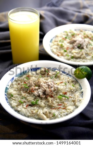 Photo of chicken porridge also known in the Philippines as chicken lugaw or arroz caldo #1499164001
