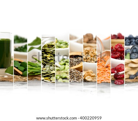 Photo of chlorella, berries and seeds abstract mix slices; healthy eating, dieting and detoxication concept; white space for text