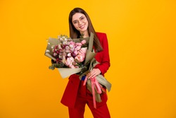 Photo of classy attractive business lady worker hold big flowers bunch colleagues birthday present wear specs red luxury office blazer blue blouse suit isolated yellow color background
