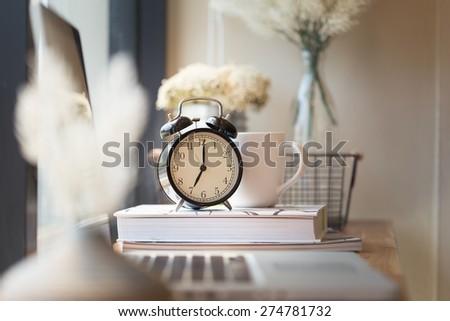 photo of clock on office desk.