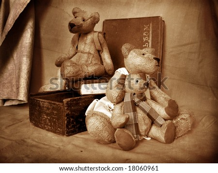 Photo of collection bears. They sit on a table in an environment of antiquarian subjects of a life. Bears are made of flax and filled by sawdust.