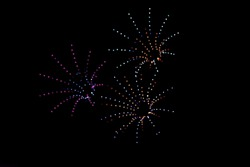 photo of colorful bokeh these drone light shows could replace fireworks on night sky background. made fireworks by drones
