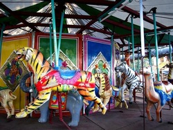 Photo of colorful carved animals of a carousel ride