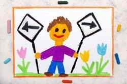 Photo of colorful drawing: Left and right arrow signs. Future and past concept. Smiling boy holding two signs.