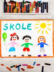 Photo of  colorful drawing: Swedish word SCHOOL and happy children. First day at school.