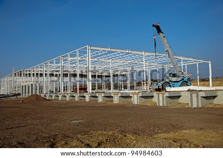 Photo of construction site of modern warehouse