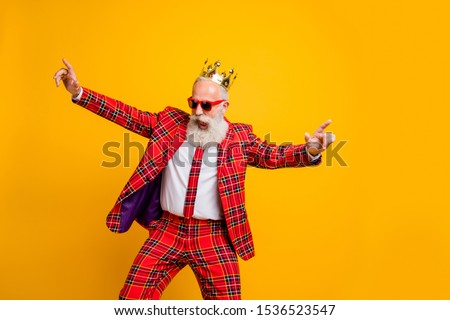Photo of cool look grandpa white beard vip guy dancing strange youth moves little drunk wear crown sun specs plaid red blazer tie pants outfit isolated yellow color background
