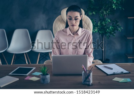 Photo of corporative ceo pondering over corporation development staring into laptop screen wearing spectacles #1518423149