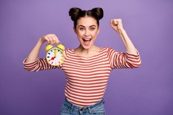 Photo of crazy attractive lady hold colorful alarm clock morning awakening in time not late work all week wear white red casual striped shirt isolated pastel purple color background