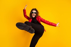 Photo of crazy girl raise leg wear trousers isolated over bright shine color background