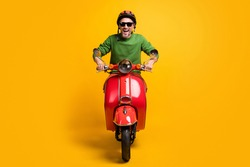 Photo of crazy man ride cycle open mouth wear helmet sunglass green pullover isolated yellow color background