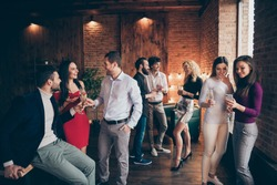 Photo of crowd of working people engaged in business having corporate party with fun and alcohol wearing formally talking with each other shaping communication