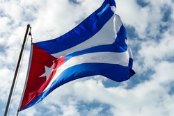 Photo of cuban flag against sky in windy day